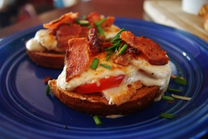 A finished Kentucky Hot Brown on a blue Fiesta Ware plate.