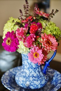 For this particular arrangement, my daughter and I chose a variety of blooms all within the zinnia family in varying shades of pink. To keep it bright and really make our pinks stand out, green hydrangeas were chosen as accent blooms. Lastly, we chose a purple wildflower as filler. Many times though, greenery is chosen as filler.