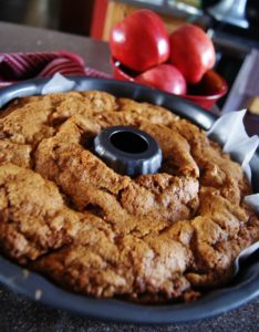 A fully baked fresh apple cake with walnuts