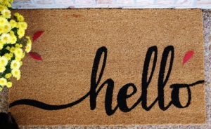 A new welcome mat is a great way to add oa touch of fall to your front door.