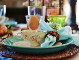 Upclose view of woodland Easter tablescape tea cup.