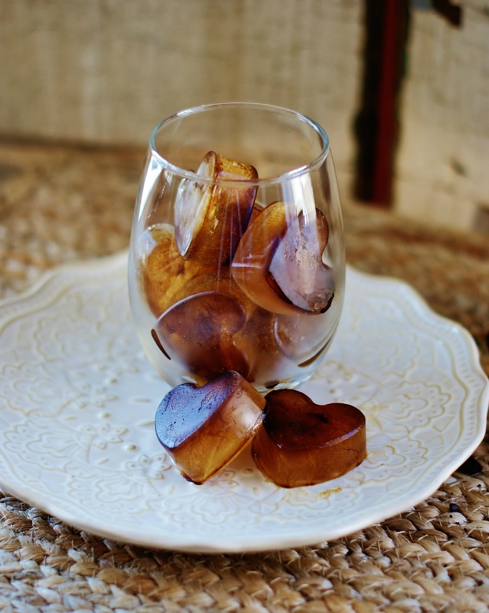 A glass full of heart shaped coffee ice cubes for easy iced coffee.